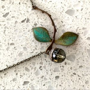 Jewelry - Smokey crystal acorn and delicate green necklace